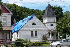 Clinton Church with blue tarp on roof